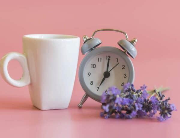 5 am wake up, alarm clock and a coffee mug